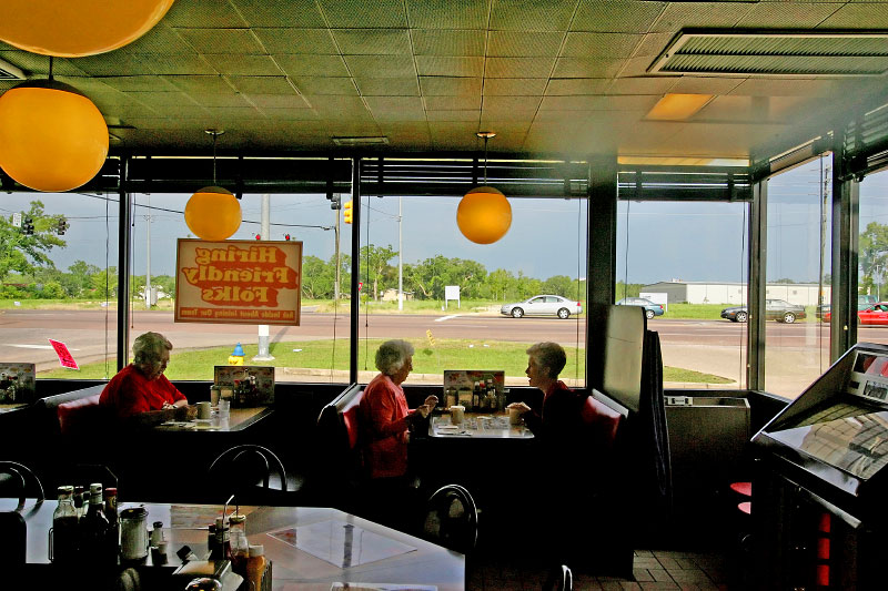 Diners at the Waffle House in Mobile, Alabama along Highway 90 nine months after Hurricane Katrina.