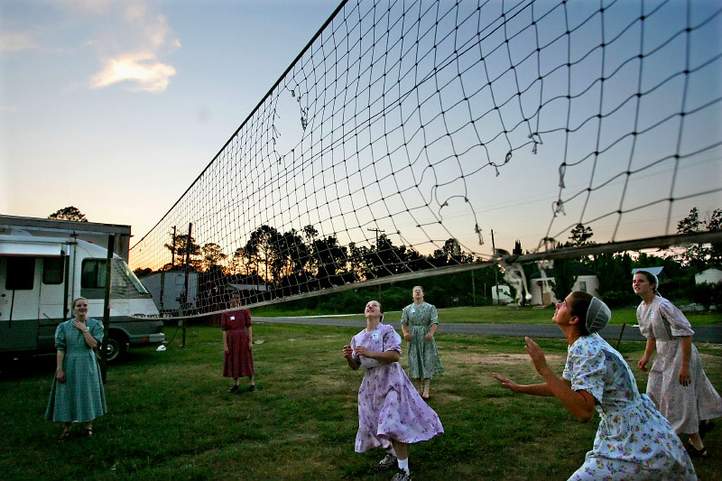 Volunteers from Pennsylvania working for the Mennonite Disaster Service, gather for a game of volleyball after their day of service in the Bayou La Batre community, hard hit by Hurricane Katrina.