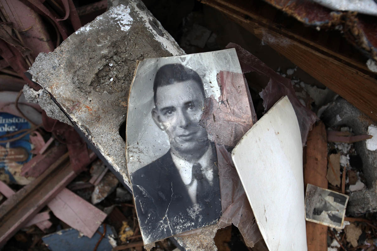 Old photos were scattered on the ground where the auto dealer ship used to be. The stamp on the back of the photos credited Murwin Mosler, (who graduated from Joplin high school in 1935) a photographer who documented Joplin. This photo was blown from his archive storage from across the street.
