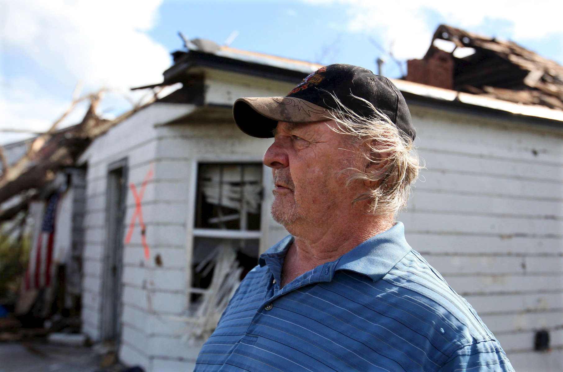 20110525 Joplin, Missouri (NAT)  Tornado aftermath in Joplin, MO. Resident Franklin Gregory, 66, who is living in a shelter at the University, surveys his neighborhood on Annie Baxter Street.  (dan story) Nicole Bengiveno / New York Times