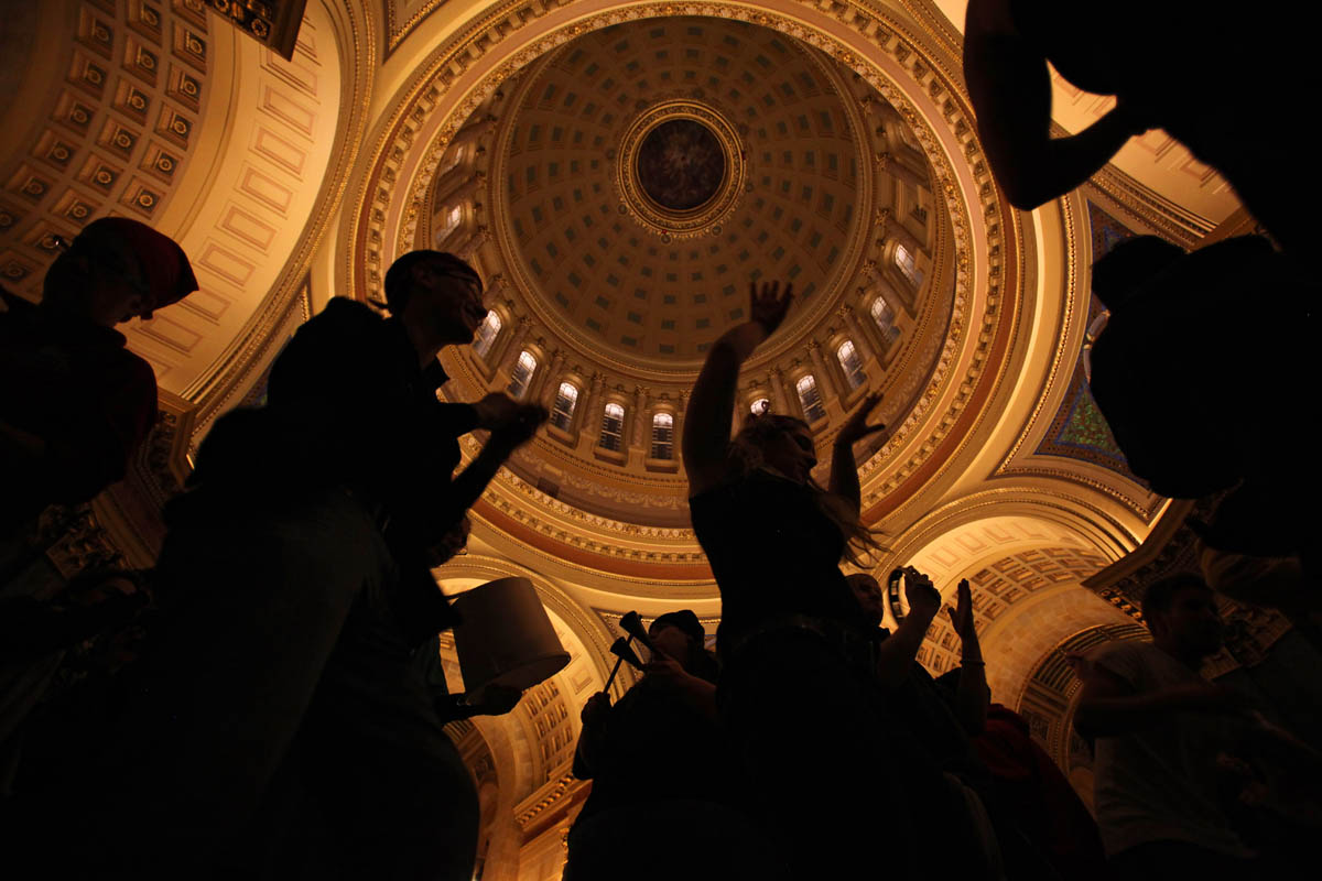 Union supporters and various tribes of protesters make a stand inside the State Capitol building on a 24/7 mission. As the evening progressed, celebration began when it was announced that protesters would be allowed to stay for another night. Some danced as other played drums and make-shift instruments.