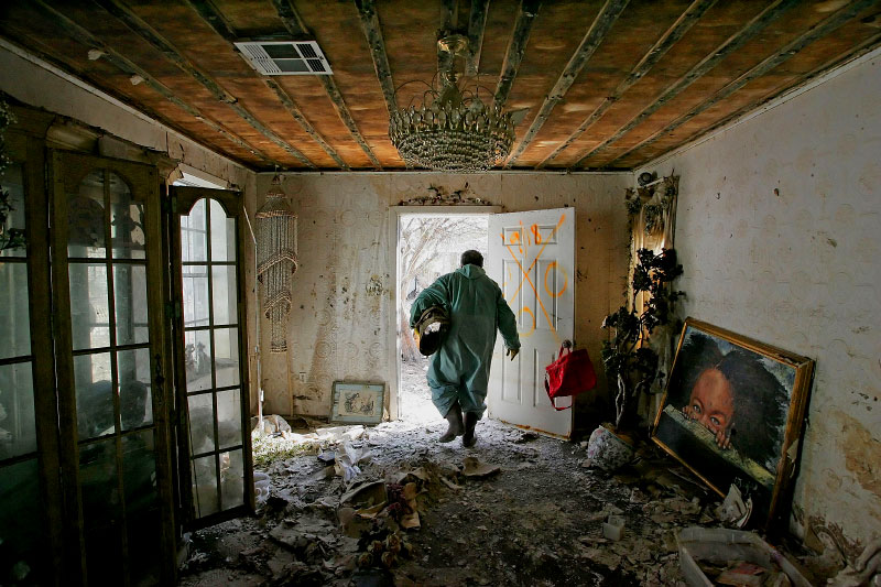 New Orleans Ninth Ward opened to residents after being closed due to dangerous conditions after flooding from Hurricane Katrina. Residents bought their own hazmat suits and came home to start the clean-up.