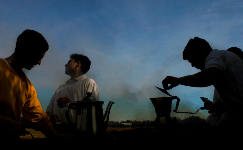 Brothers from the Legionaries of Christ in  Connecticut gather around a grill for an outdoor barbeque at Hammonassett State Park in Madison, Connecticut.  Left to right are AllanWirfel, Alex Mijangos, and Peter Wimer.
