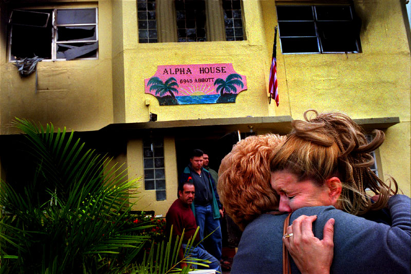 Maria Exposito, right, hugs Lenore Raven outside the Alpha House, a drug recovery center.  Raven's son is a resident of the house and escaped the fire by jumping out one of the second floor windows. Exposito is not a resident, but came here each day as part of her recovery program.  She says that now she does not know where she will go because Alpha House was the only recovery house of its kind in North Miami Beach.