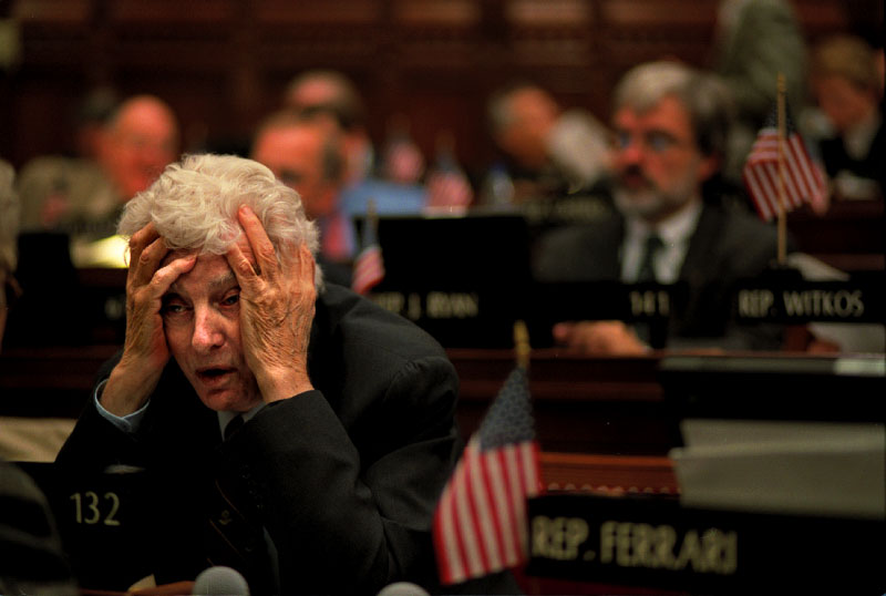 Republican State Representative Carl Dickman holds his head during a marathon budget session at Connecticut'sCapitol that promised to drag on well into the night.