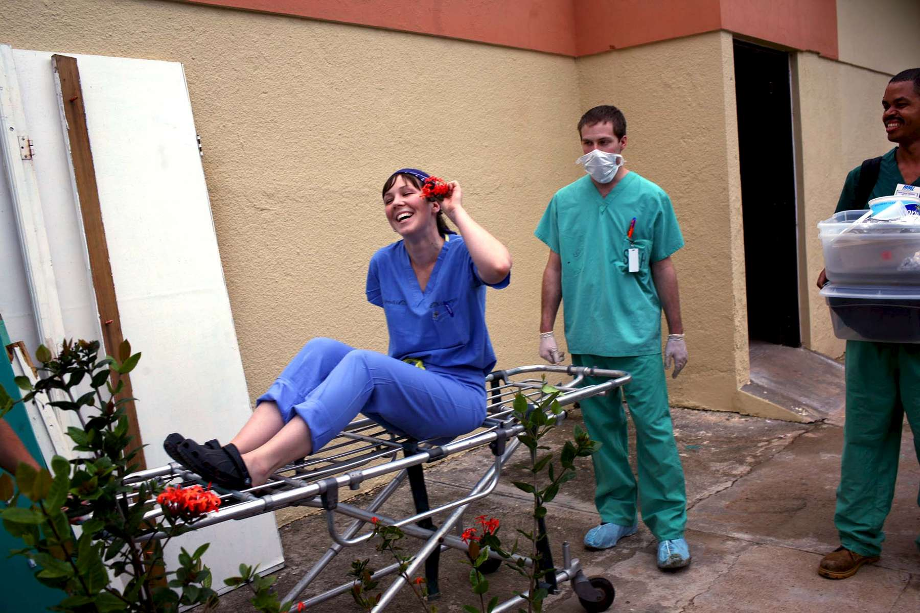 Hilarie Tomasiewicz, a medical student, kids around while she hitches a ride on a stretcher. This was her first medical trip.