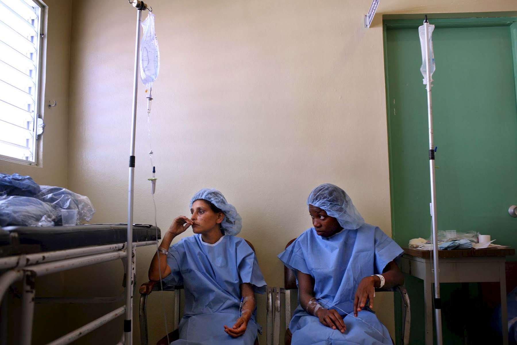 Abilina del Carmen, left, and Elba Rodriguez wait before their surgeries - both were going to have a hysterectomy.