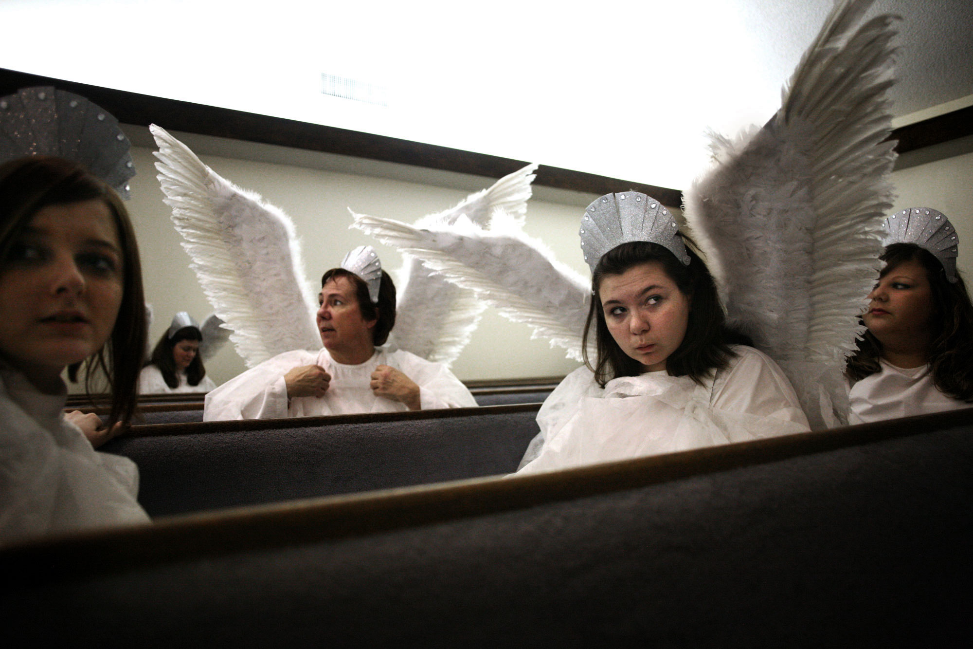 (l-r)Arynne Grove, 13, Jean Albertson, 58, Tori Albertson, 12 and Leahann Holloway, 13,  wait before their turn to take the stage at West Park Church of Christ on Wednesday, March 24, 2010 during the Passion 2010 {quote}My Redeemer Lives!{quote}. The four were playing the part of angels.
