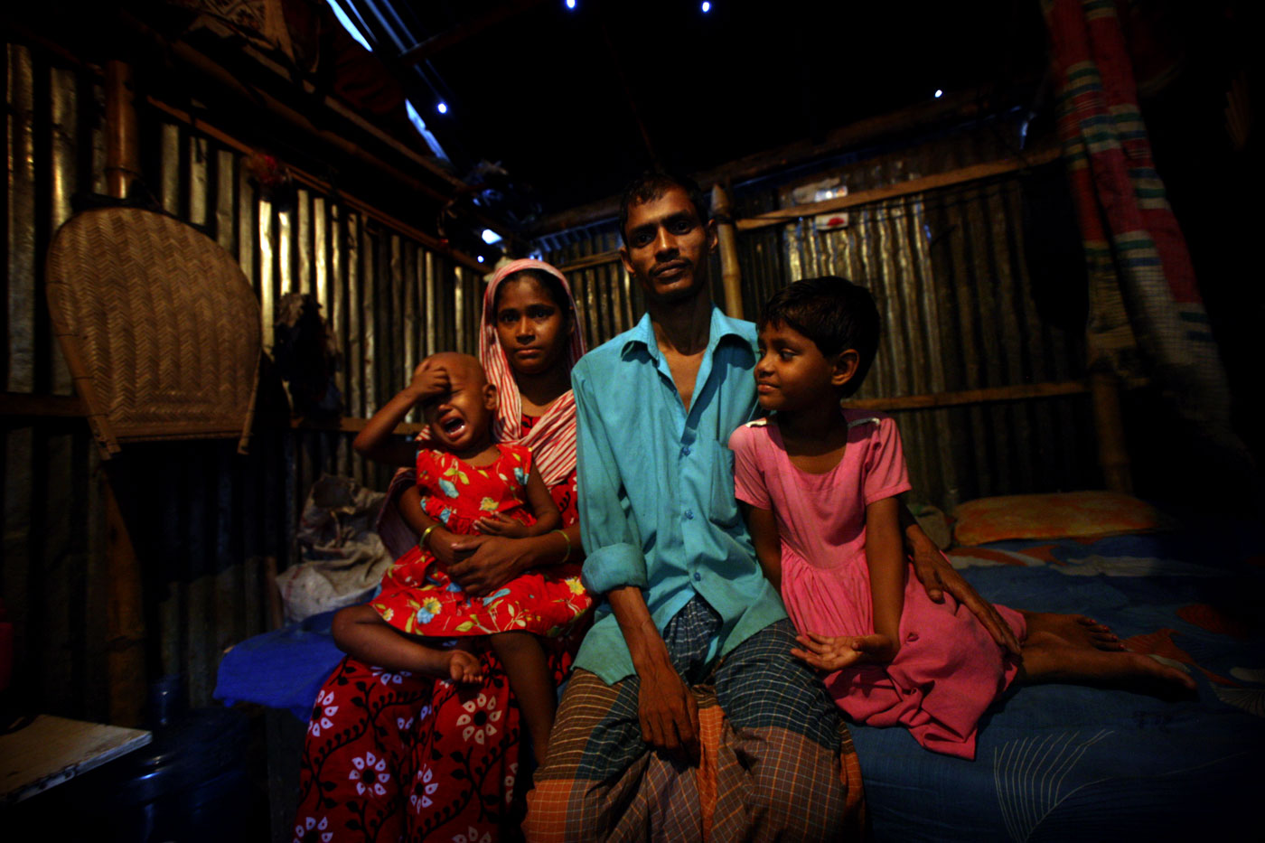 Nizam Hawladar, his wife Mahe Noor, and two children live in the largest slum in Bangladesh called Korail. This story focuses on their family, one of tens of thousands of families in Dhaka who are living in the slums. They are one of thousands of {quote}climate refugees{quote} - people who have fled their village home due to impoverished conditions attributed to climate change. They come to the larger cities in search of work, but often end up stuck in slums like Korail for years.