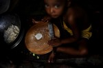 Ria, 3, makes a chapati out of ground rice - one of the staples of their diet.