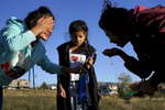 (l-r) Laxmi Adhikari, 14, Devika Subba, 14, center, and Susmita Adhikari, 16, right, wash up and brush their  teeth early one morning after a night camping out at Bear Lake Campground in Lakewood, Colo. on Oct. 14, 2017.