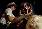 Kate Nellis, 19, whispers to her sorority sister Monica Kohli, 19, before riding the mechanical bull at Shooters Bar in Durham, N.C. At left is Jason Ellis, who works at Shooters. Both women attend Duke University.