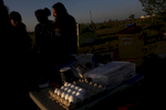 Morning light strikes across a carton of eggs which will cooked by the girls for breakfast at their campsite in Hooper, Colo. on Sept. 2, 2017. At center is Nirshika Neopany, 14, a refugee from Nepal.