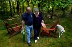 Gloria's husband, Mike Morin, helps her back inside the house after a talk in the yard - it was one of Gloria's last days outside.
