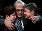 Mike Morin hugs his sisters, Lisa Langlois, left, and Lynn Flynn after her funeral services.