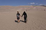 Sostika Chhetri, 14, left, and Dechen Drukpa, 14, right, walk together after arriving at the Great Sand Dunes National Park and Preserve on Sept. 2, 2017.