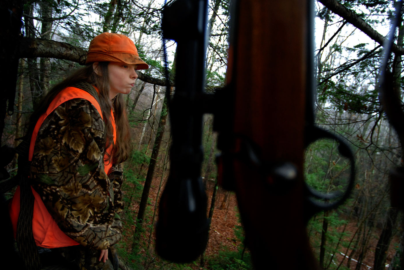 Beth Irwin waits patiently in a tree stand while out deer hunting with her father, Tim. Beth, 13, didn't shoot any deer but did see a few in the distance. For hunters, learning to be patient is an integral aspect of hunting; and just seeing deer and various aspects of nature is one of the many enjoyable parts of hunting, all of which requires a hightened level of patience.