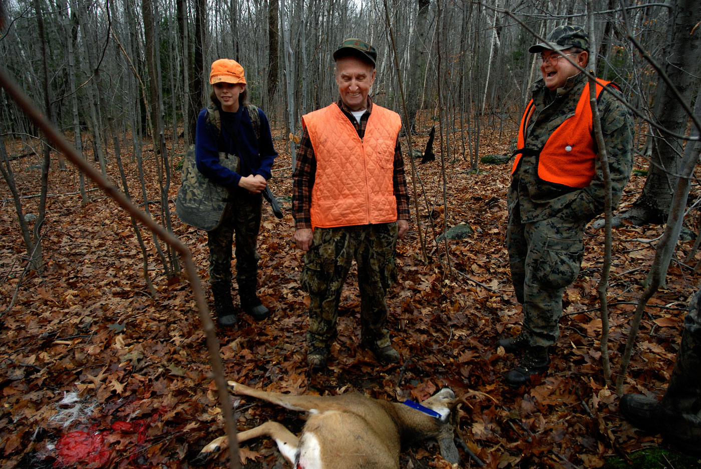 Don Joy, left, 68, of East Hartland, reacts with excitement for Bob Vezina, 77, of Hartford, after he shot a deer on the first day of the season. At left is Beth Irwin, who was hunting with her father, Tim, nearby the two men. Joy and Vezina have hunted together for 40 years. {quote}I was as happy as if I had shot it myself,{quote} said Joy, who scouted out the stand for his friend Vezina. {quote}We don't really need to get a deer while we're out - if we get one it's great, but it's more just being out there and enjoying nature.{quote}
