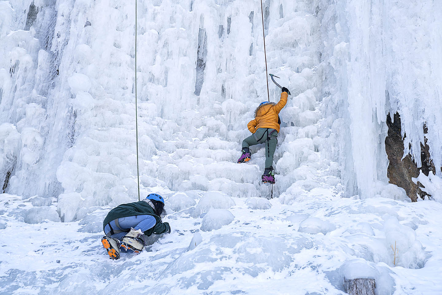Sapana Rai, 14, left, and Susmita Limbu, 14, right, work their way up during an ice climb at Camp Alexander at Lake George, Colo. on Feb. 17, 2017. The camp is run by the Boy Scouts of America.