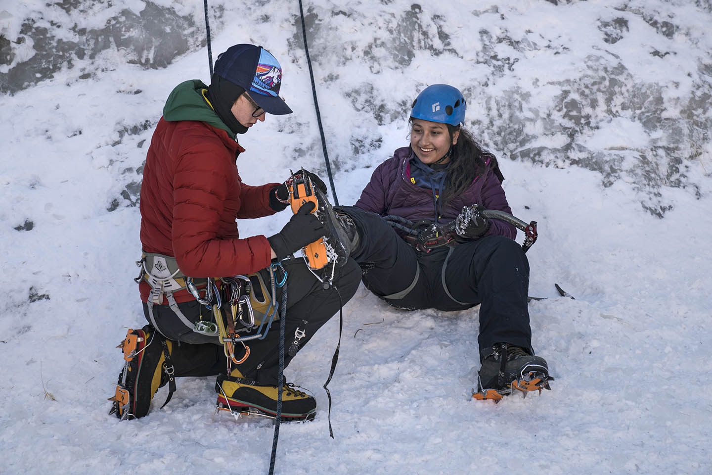 Climbing guide Dillon Diering, 22, left, helps Nirshika Neopany, 14, right, prepare for an ice climb at Camp Alexander at Lake George, Colo. on Feb. 17, 2017. The camp is run by the Boy Scouts of America.