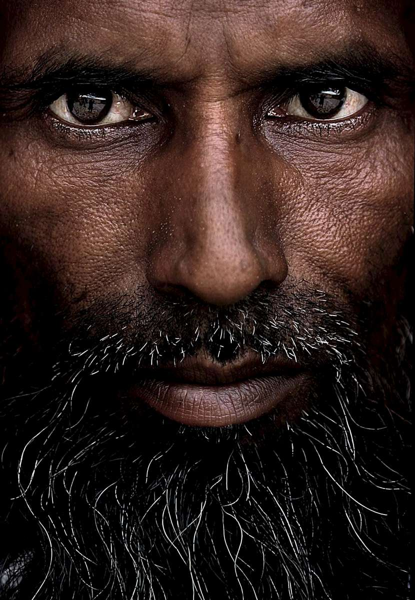 An Islamic man poses for a portrait outside a mosque in New Delhi.
