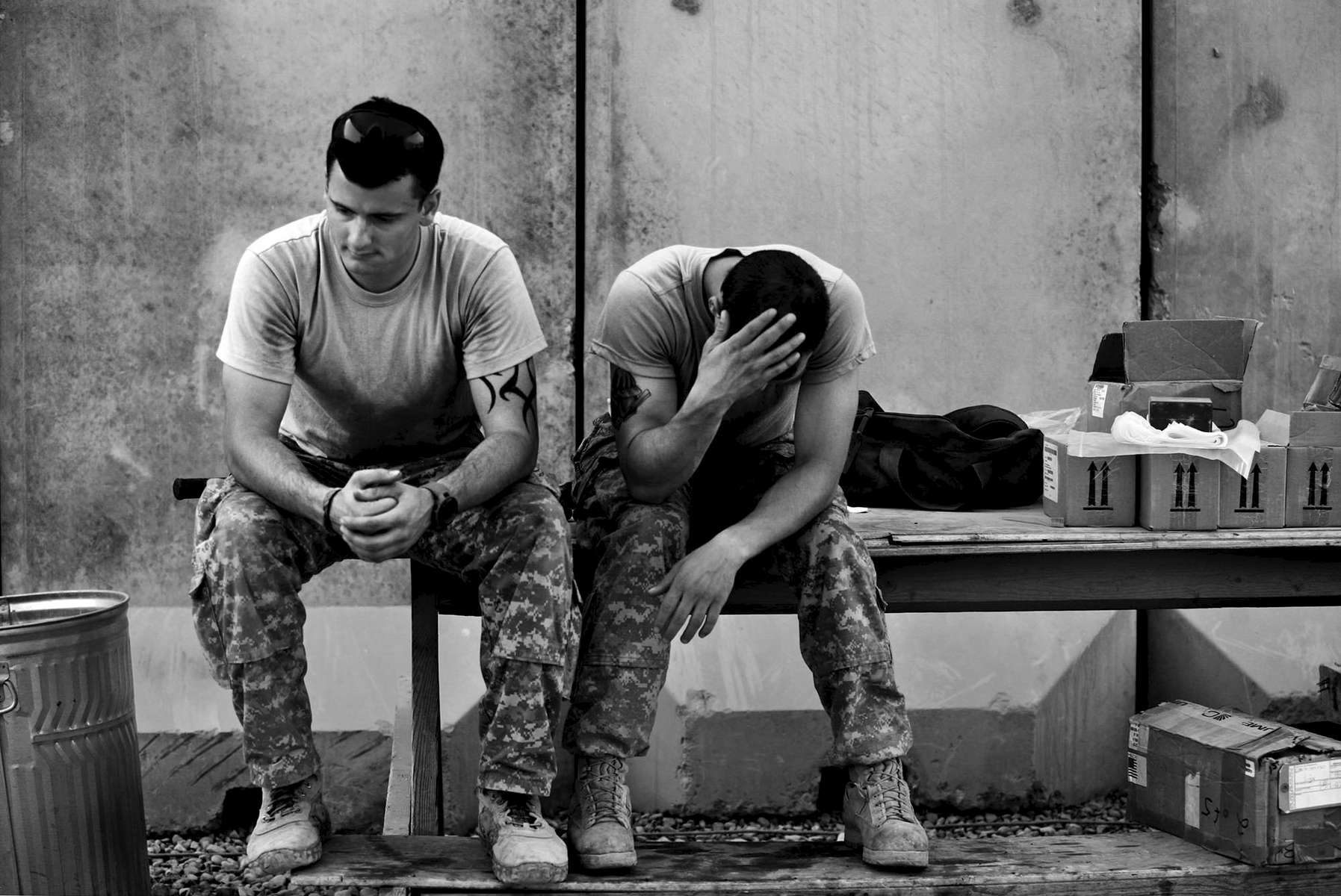 (l-r) Pfc. Christopher Scott, 20, of Dumfries, and Spc. Sam Sivers, 23, of Mt. Sidney, wait for their next assignment while at Camp Adder. As the war winds down, there increasingly is less to do for the troops than before.