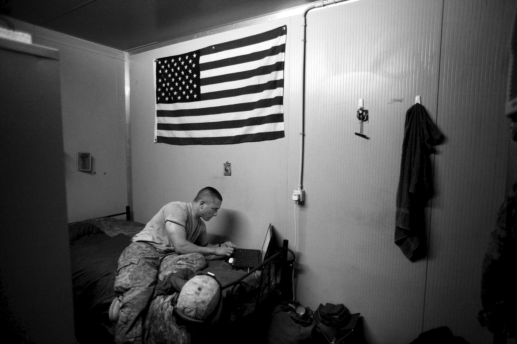 {quote}Everybody should do something for their country,{quote} said Specialist Ricky Chittum, 24, Here he checks the internet at Camp Adder in his room shortly before returning home. He's looking for a new dog to replace his old one which was stolen while he was on deployment. Chittum says the search for a dog is a symbol of his pending return home. {quote}A dog is a best friend. I don't have a wife to come home to and a dog is a good companion.{quote} Chittum is from Covington.