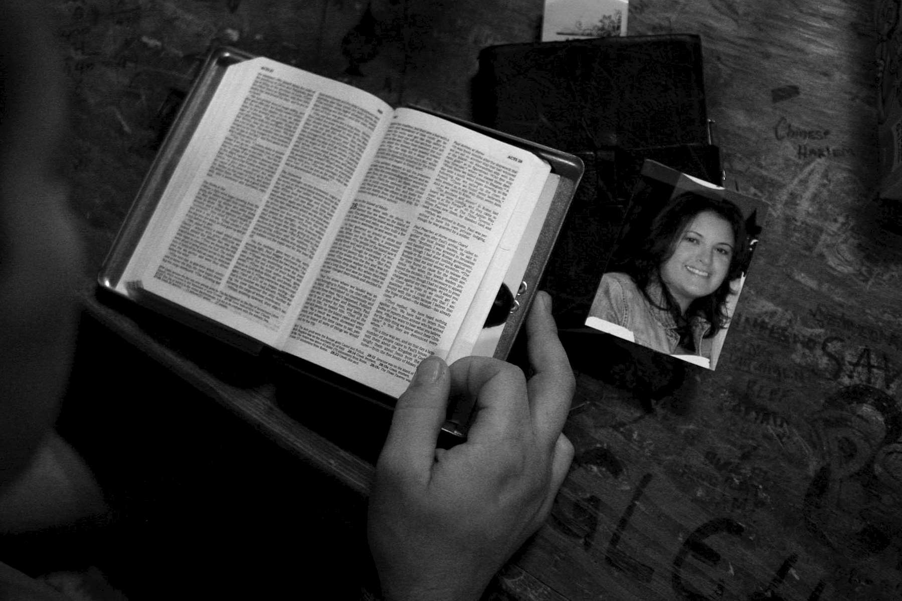 Alvin Boguess, 24, of Covington, reads the bible at Camp Taji in Iraq not long before heading out on his final convoy mission. {quote}I try to read the Bible before every mission,{quote} said Boguess who keeps a picture of his wife, Shannon at the side while he reads. {quote}It (the picture) reminds me of what I've got back home.{quote}