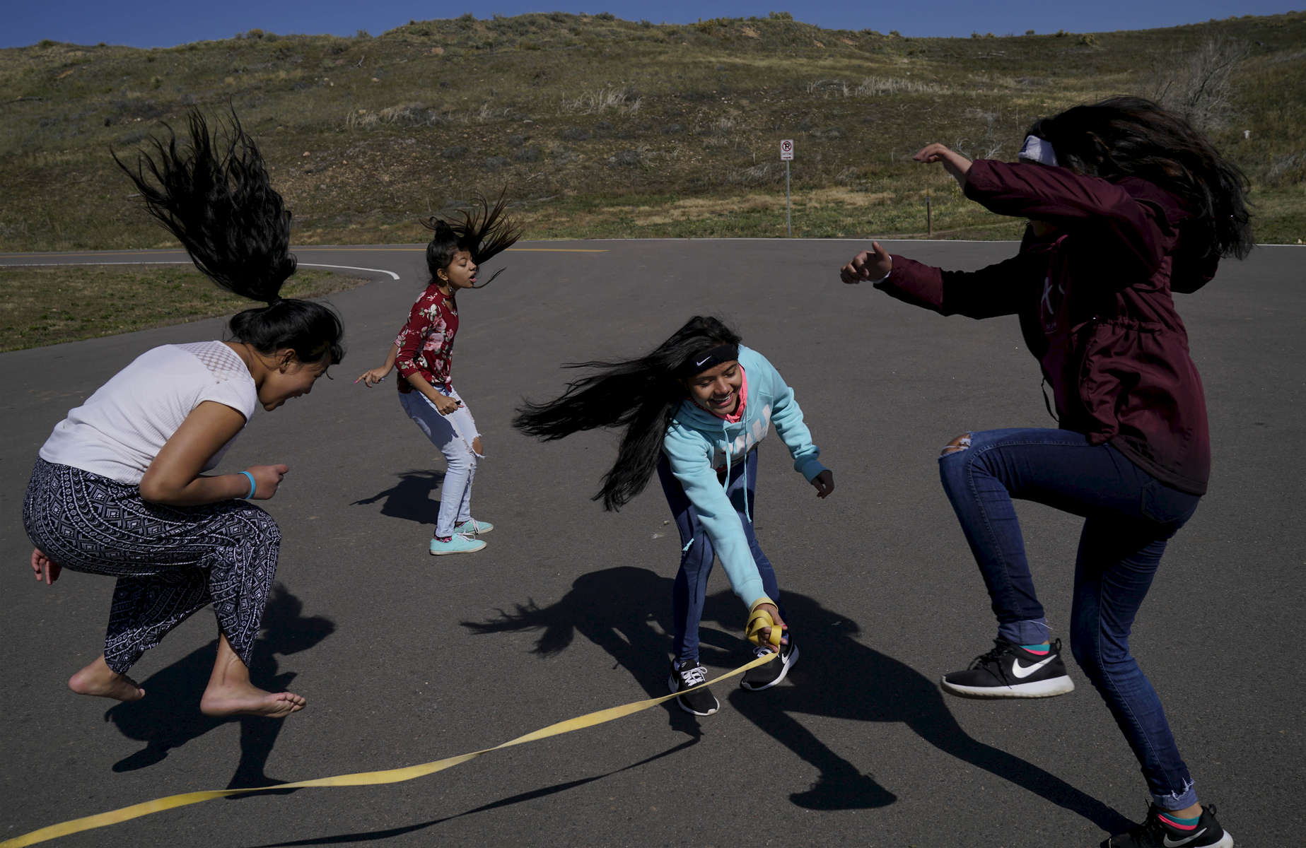 (l-r) Samita Subba, 14,  Devika Subba, 14, Laxmi Adhikari, 14, and Susmita Adhikari, 16, play together during a campout at Bear Lake Campground in Lakewood, Colo. on Oct. 15, 2017.