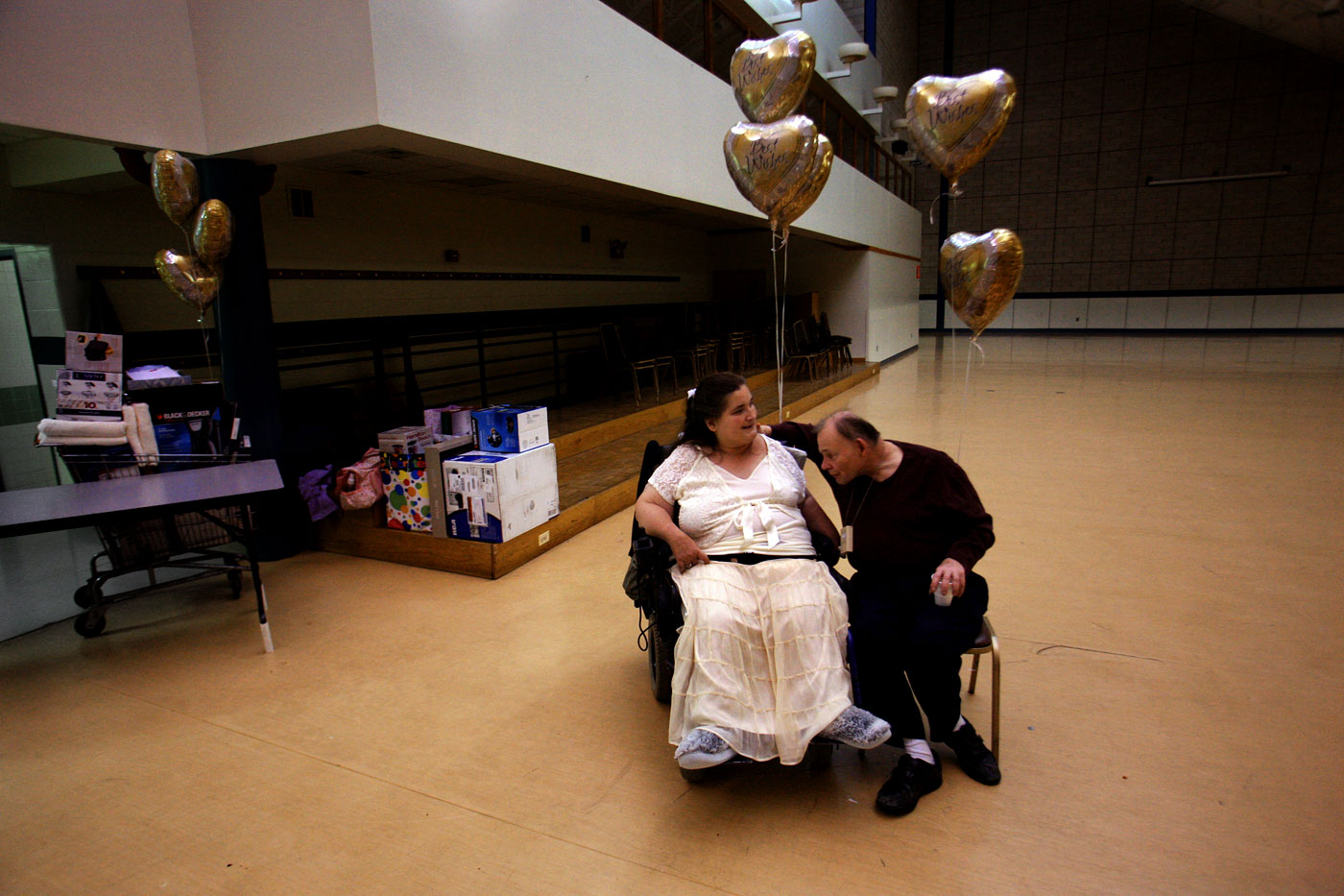 The happy couple share a quiet moment together during a wedding shower at New Horizons.
