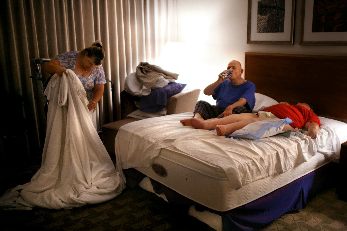 Becky Clark prepares the {quote}honeymoon{quote} bed for Tom and Theresa as they lay together for the first time. Clark is one of the personal care attendants for the couple.