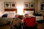 "Tom and Theresa sit in their honeymoon suite at Mohegan Sun, quietly waiting for the moment they'll share a bed together for the first time. They wait for Becky Clarke, their personal care attendant, who has come to help Theresa into the bed with a special metal lift. ""[The honeymoon] was our getaway from the cares, from New Horizons, from the worry of shopping and…planning anything,"" says Tom. ""We were just living it up, really. And to do it together was just awesome."""