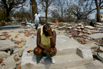 Mississippi resident Glenda Thomas sits on the steps of what used to be her home after it was destroyed by Hurricane Katrina. Thomas was a lifelong resident of Gulfport and said she wasn't sure where she would go to live.