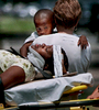 A child stares at his mother who was involved in a vehicle accident on Hilton Head Island. The child escaped unharmed.