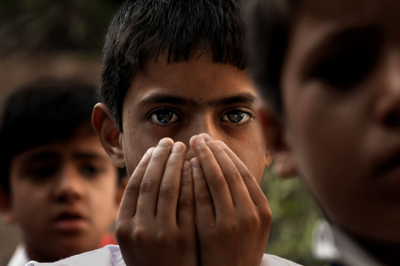 Zahoor Ahmad looks up during morning prayers before heading into school.