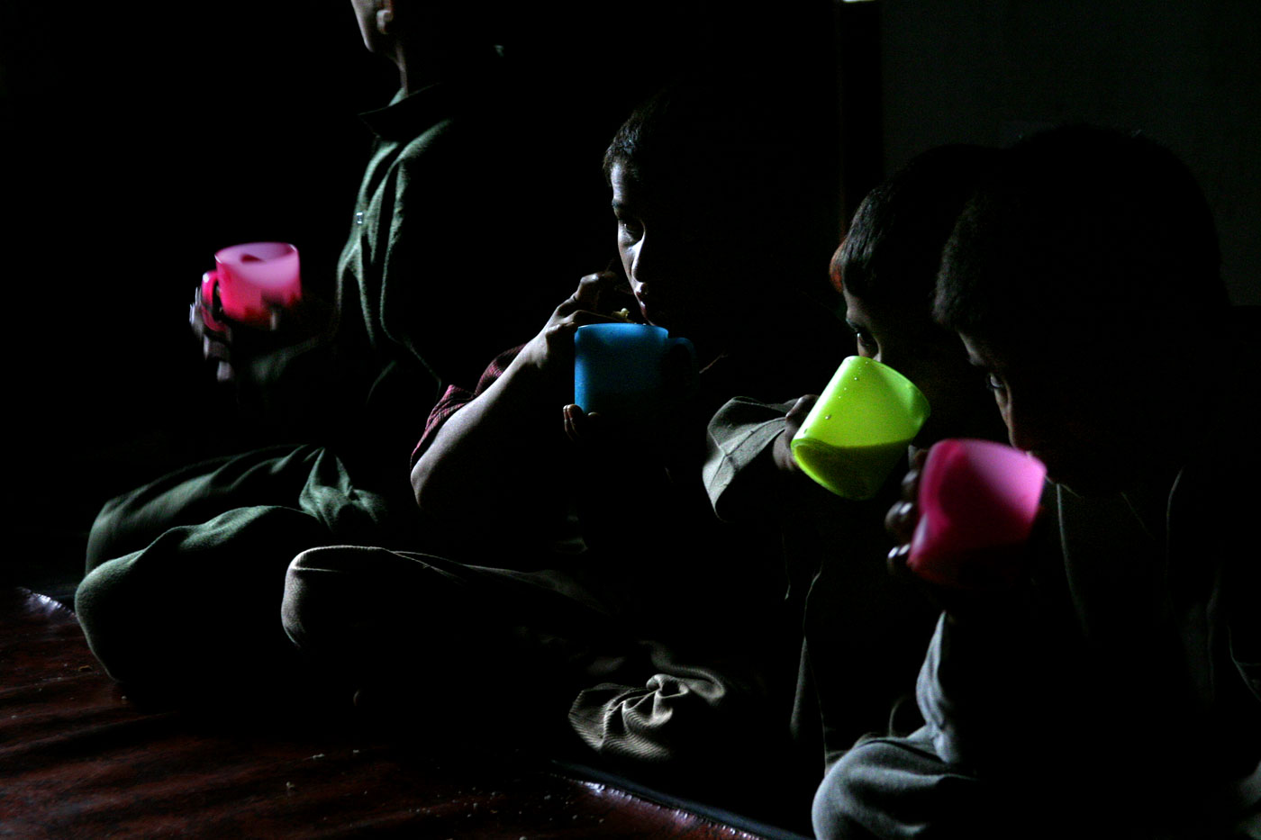 Light pours in and is highlighted in the colored cups the children use for an afternoon snack and drink.