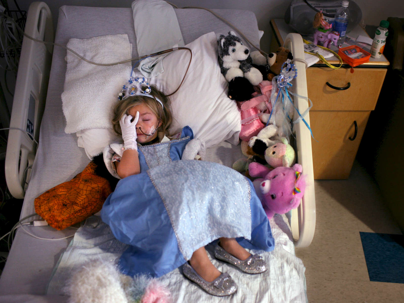 Lindsey Reelick, 4, rests while dressed as Cinderella at Connecticut Children's Medical Center . Reelick and others children in the hospital were recipients of the {quote}Reverse Trick or Treating{quote} where staff  members came by and delivered goodies to the children. {quote}All the doctors and nurses have been really fantastic,{quote} said Dana Reelick, her mother. {quote}They have made it fun for her - they've made it a special day.{quote}