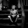 Carlos Rose, 8, lives in McDowell County, West Virginia, and is the youngest of ten children. McDowell County is one of the poorest counties in America.