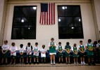 """Teammates tether to a line that serves as their bench, and they bow below an American flag. It's spirit Night at Holy Trinity School in Ocean View.  After a few moments the athletic director, Dan Holmes, gathers a microphone and strings it out onto the court.It's time to pray.""""One of the really unique things about this program, is that you don't necessarily have to go to the school to participate in basketball"""" said Holmes, of Norfolk. """"The basketball team is open to all members of the parish. You can send your kids to public school and still have a faith-based athletic program. That's one of the things we're really proud of.""""The school, which is in it's 85th year, combines expressions of faith along with its athletics; and on this night, their winter sports season is kicked off with the Lord's Prayer.Moments later, the children bolt from the line and smiles split across their faces.It's time to play."""