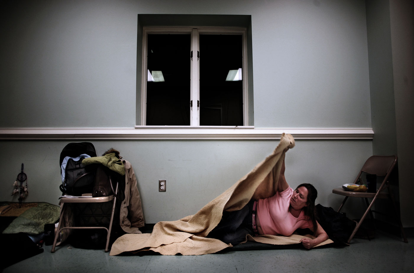 """Julie Burks slips off her shoes and exhales softly.She pulls her coat over her purse – her pillow for the night - then lays down and stares into the distance.""""It feels good that I'm not out in the cold,"""" says Burks, who is homeless. """"When I was out there, the first thing I would do is drink. I would shiver all night - I didn't sleep. At least drinking keeps me warm.""""Burks is trying to kick the habit and has been clean for the past few days.On this night, she and other homeless people are sleeping at Lynnhaven United Methodist Church in Virginia Beach. Burks is one of dozens assisted by Volunteers of America, which works in partnership with area faith communities to provide shelter throughout the winter.""""I can handle it out there, but it's very difficult, especially when you're trying to stay sober and get your life back in order.{quote}"""