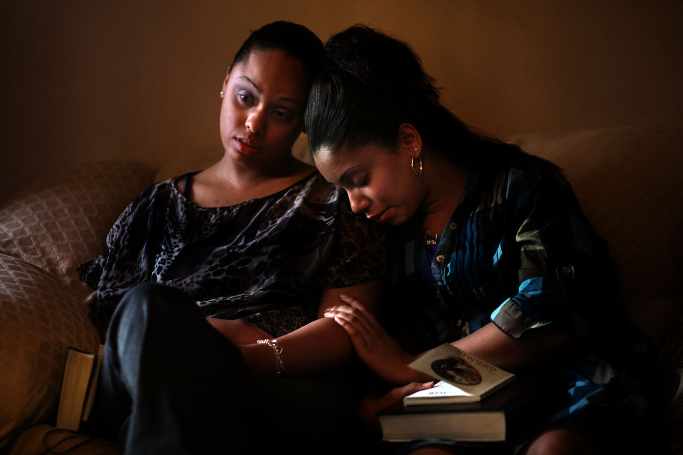 A soft afternoon light spills into the living room and Keiyana Vincent, 18, leans into her sister, Tara, 21.The two just finished their weekly family bible study and closed with a prayer.The final days are coming, and the family is bracing for a new reality.Their father, Ralph Vincent, is about to lose his job of more than 30 years in Franklin, Va. International Paper, the town's primary employer, is slated to close and Ralph's last day is soon. He is the family's main source of income and the sisters still live with their parents.The family knows they'll have to move, but the two daughters rely on each other, and their faith, for strength in these trying times.