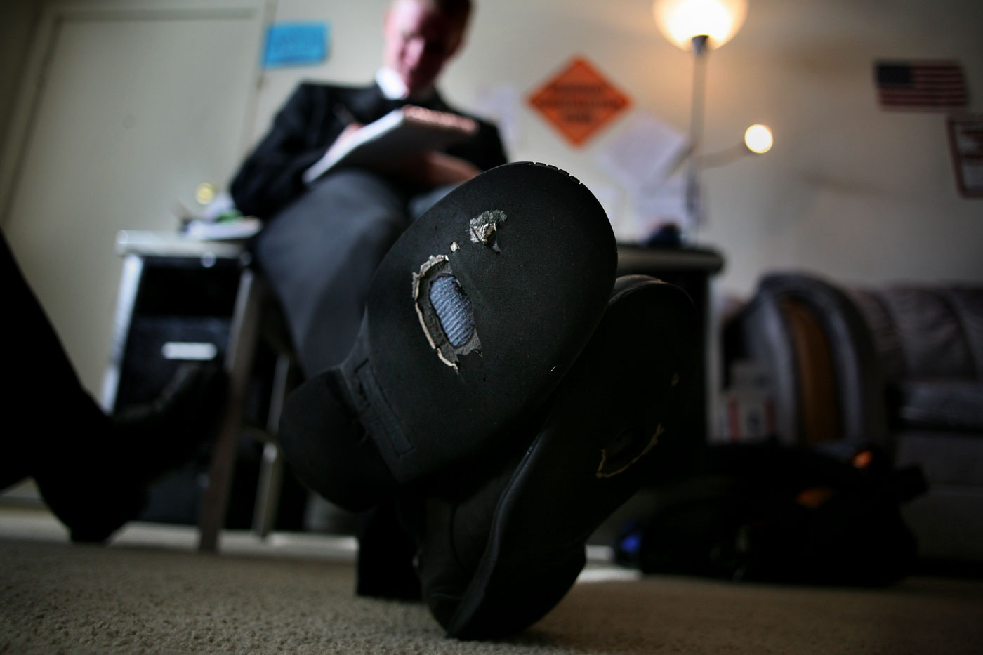 The holes tell a story - a story of almost two years of travels. And while Riley Petersen can afford another pair of shoes, he choses not to. The Mormon missionary is almost at the end of his two-year stint.{quote}They're a symbol of the past two years,{quote} said Petersen, who smiles as he recounts the thousands of miles he has walked, biked and driven in an effort to spread the Mormon mission.