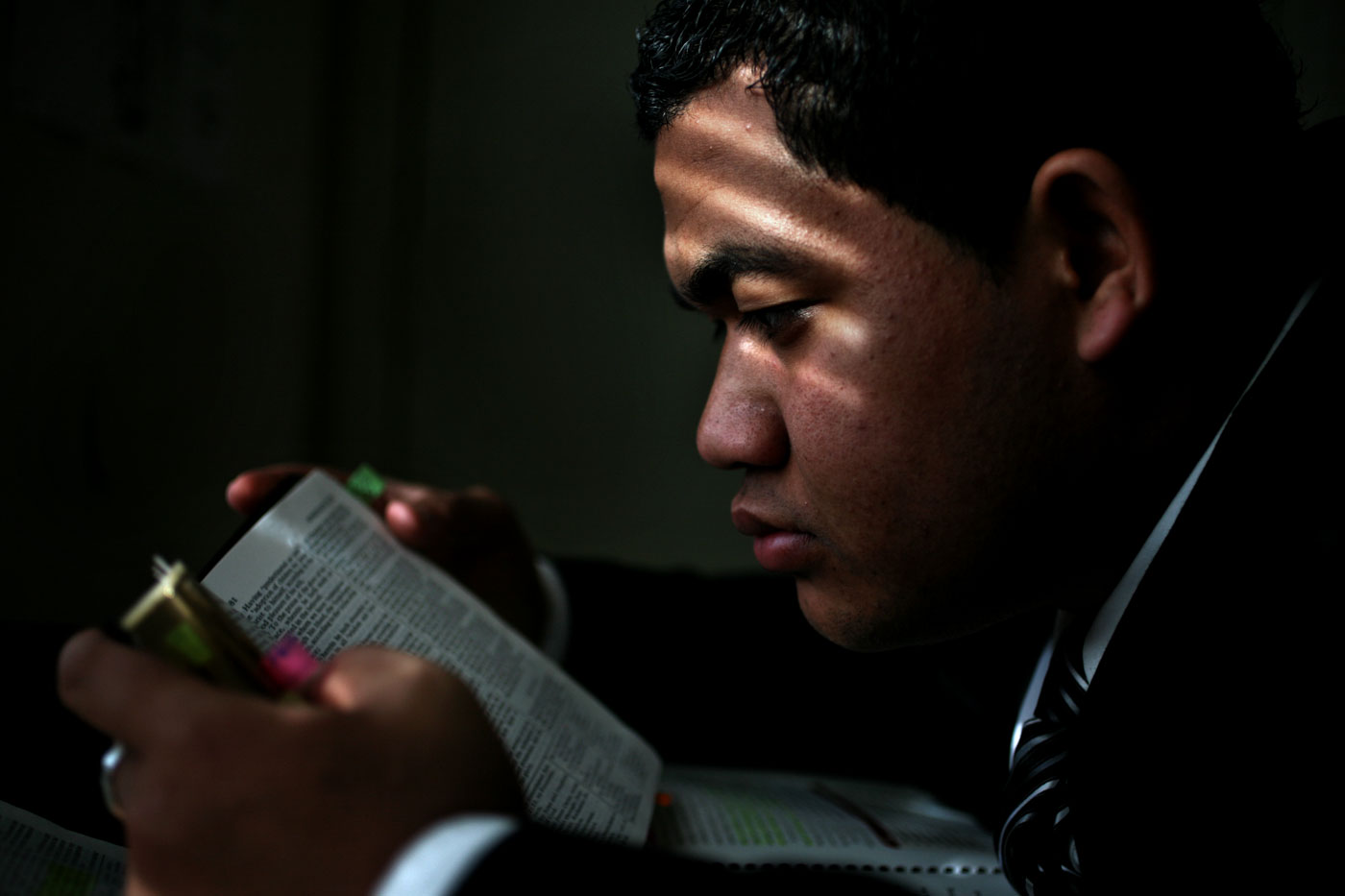 Pauliasi Wolfgramm reads the Bible in his Virginia Beach apartment as morning light sifts through the shades. He reads the bible each morning to start his day. Orginally from Tonga, he is learning to speak and read English. {quote}No matter what the language is, the message is the same,{quote} said Wolfgramm of the Bible.