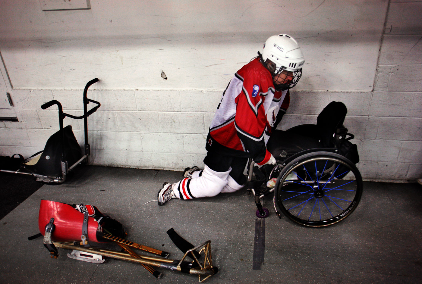 Connecticut Wolf Pack's Kelly Hutchings gets back into her wheelchair after a match at Danbury Ice Arena. Hutchings is in her 5th season with the team.