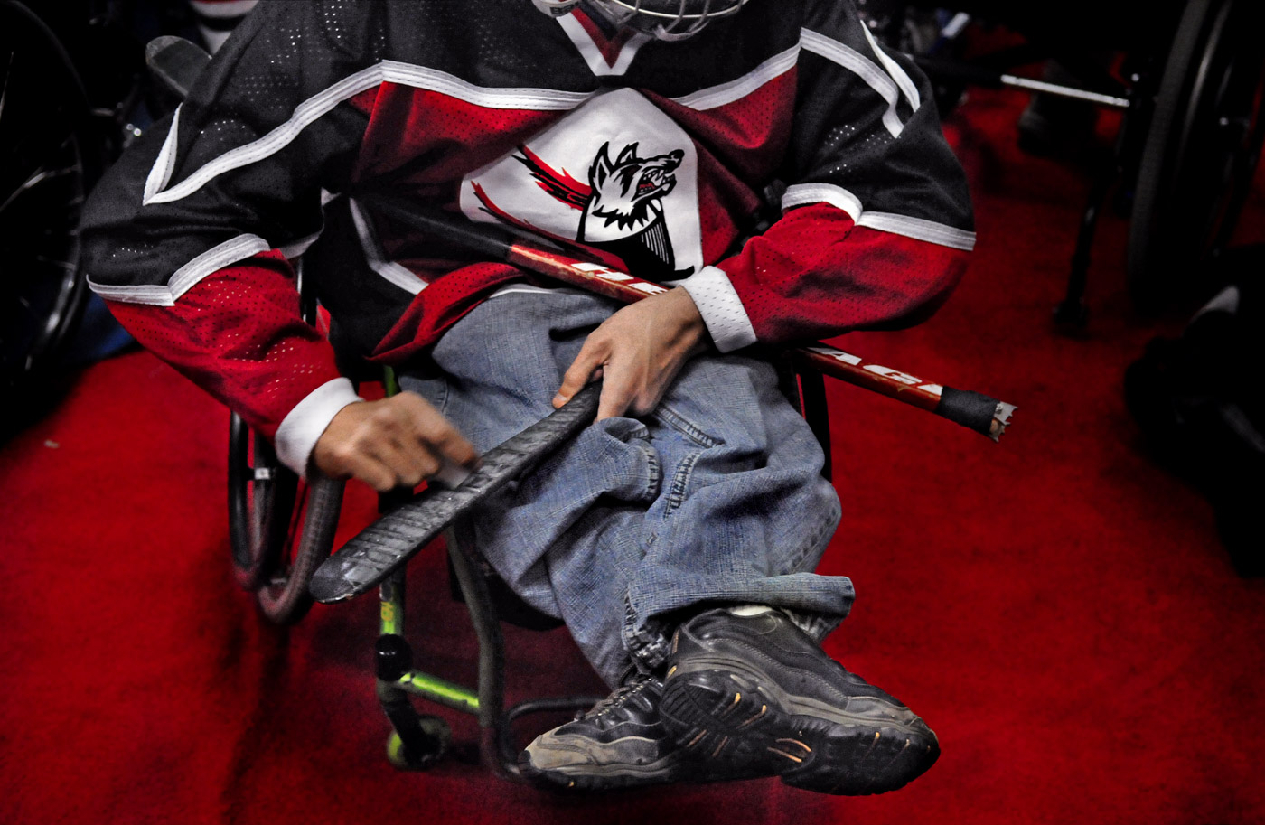 Robert Jenner chalks up his hockey stick before a match at the XL Center in Hartford. The team was playing against local television and area {quote}celebrities.{quote}