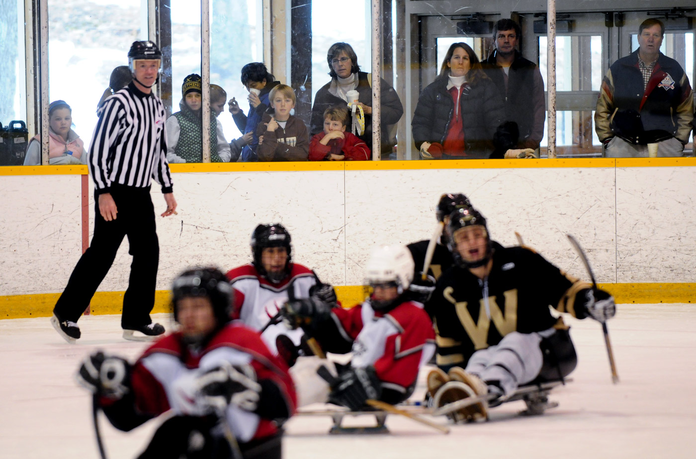 Spectators watch the action during a exhibition match between the Westminster high school hockey players and members of the Wolf Pack.