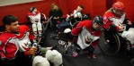 Players (l-r foreground) Josh Buglione, 19, Erica Mitchell, 21, and Colleen Rock, 17, prepare to take the ice before a match.