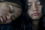Saruna Rai, 14, left, and Sumina Magar, 14, right, sleep in the back of the van after they visited the Great Sand Dunes National Park and Preserve, Colo. on Sept. 2, 2017.