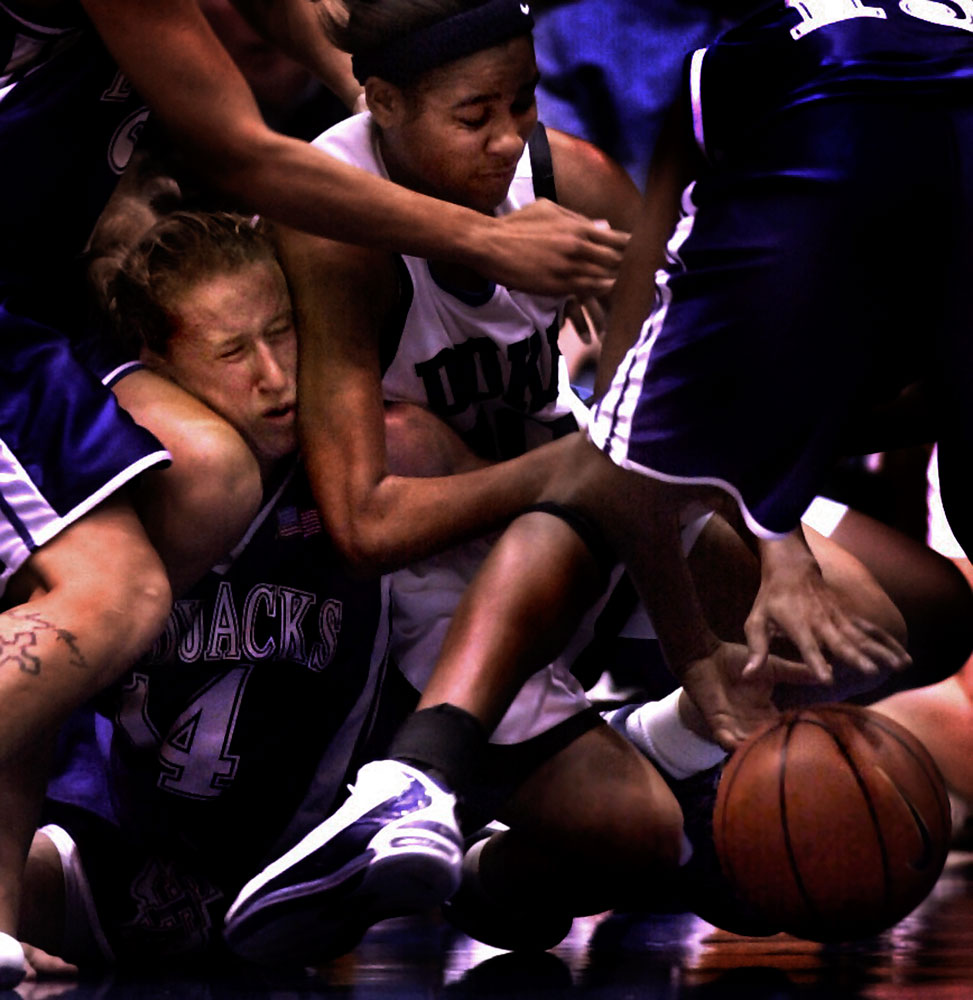 Duke's Lindsey Harding and Stephen F. Austin's Kirby Killingsworth, left, fight for a loose ball at Cameron Indoor Stadium during a regular-season basketball game.