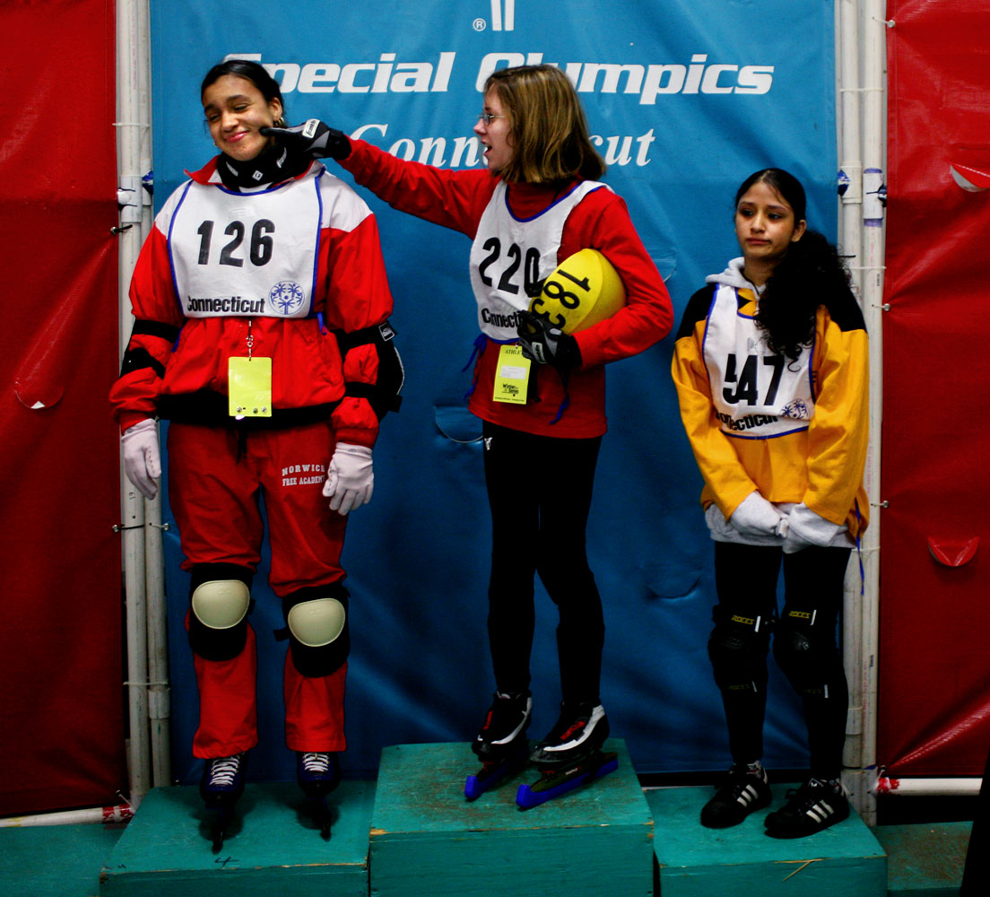 Jen Stephens, center, who won gold, tries to cheer up Karsondra Shambley, who won silver, during an awards ceremony at the Special Olympics Connecticut Winter Games. The awards ceremony was for speed skating. At right is Maria Garcia who took bronze. The event was held at the International Skating Center of Connecticut.